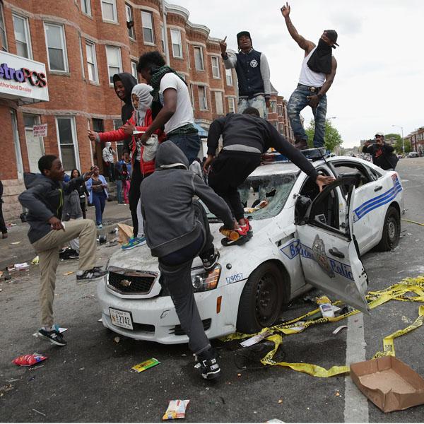 kids atop cop car