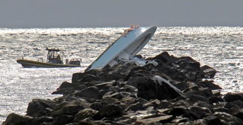 patrick-farrellmiami-herald-overturned-boat-on-jetty