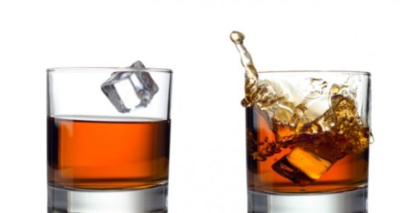 whisky-splash-isolated-on-a-white-background-credit-istock-187937983-630×445