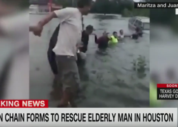 Group Of People Form A Human Chain To Rescue An Elderly Man From Flood Waters