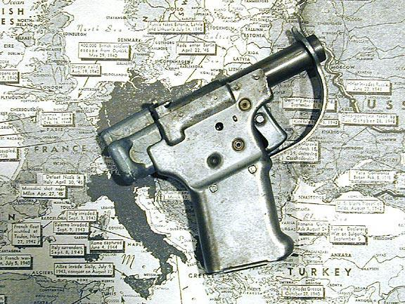 The FP-45 Liberator pistol laying on top of a map of Europe