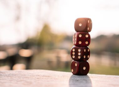 red dice stacked on table on terrace