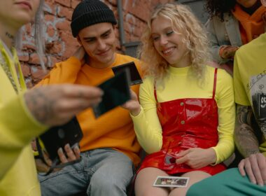 group of friends looking at the polaroid pictures