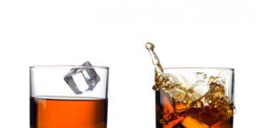 whisky-splash-isolated-on-a-white-background-credit-istock-187937983-630×445