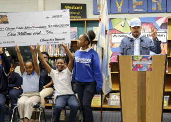 Chance The Rapper, right, announces a gift of $1 million to the Chicago Public School Foundation during a news conference at the Westcott Elementary School, Monday, March 6, 2017, in Chicago. The Grammy-winning artist is calling on Illinois Gov. Bruce Rauner to use executive powers to better fund Chicago Public Schools. (AP Photo/Charles Rex Arbogast)