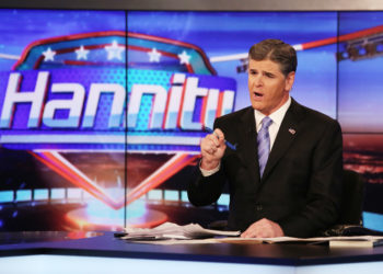 "NEW YORK, NY - APRIL 21:  Host Sean Hannity on set of FOX's ""Hannity With Sean Hannity"" at FOX Studios on April 21, 2014 in New York City.  (Photo by Paul Zimmerman/Getty Images)"