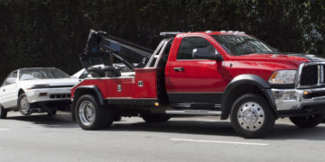 Tow truck and white prey. Nobody. Horizontal.-For more trucks, trailers, and vans, click here.  TRUCKS, TRAILERS, and VANS