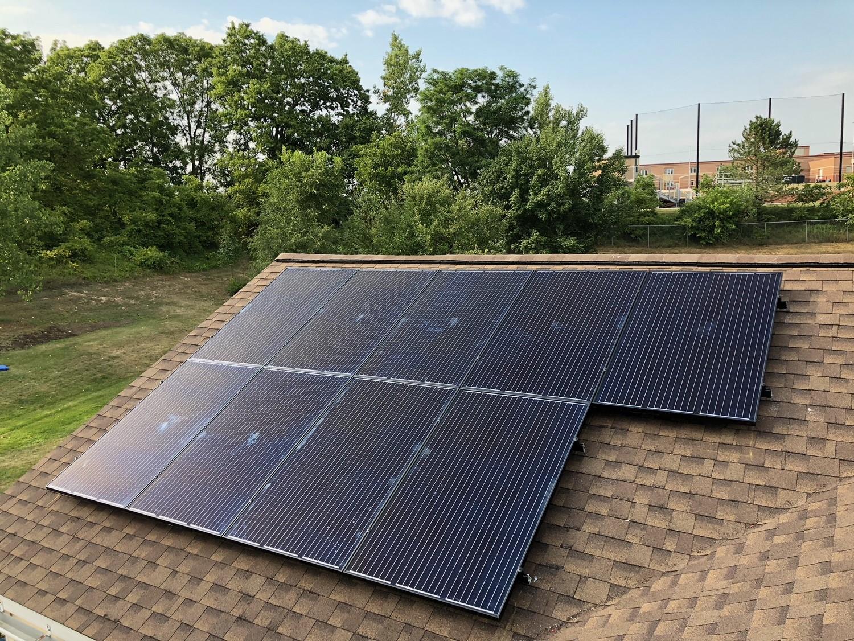 black solar panels on Spanish tiled roof