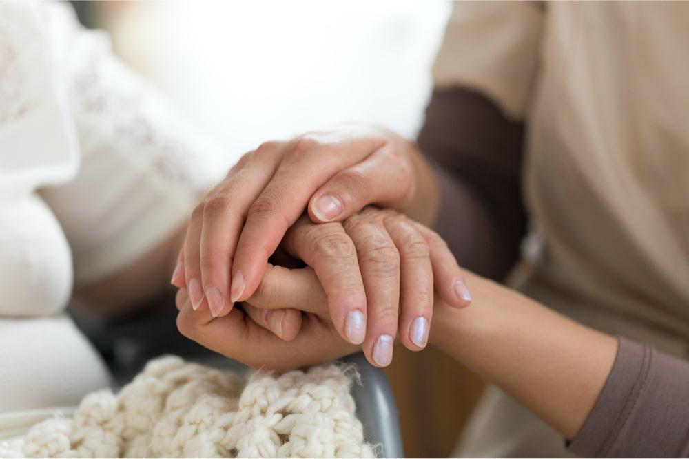 caretaker holding hand