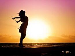 beach woman sunrise silhouette