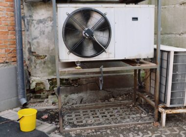 air conditioner unit near wall of modern building on street