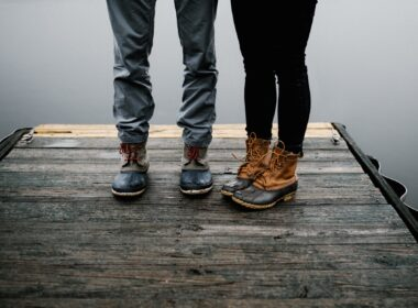 two person wearing black and brown duck boots
