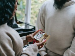 black woman receiving present from man