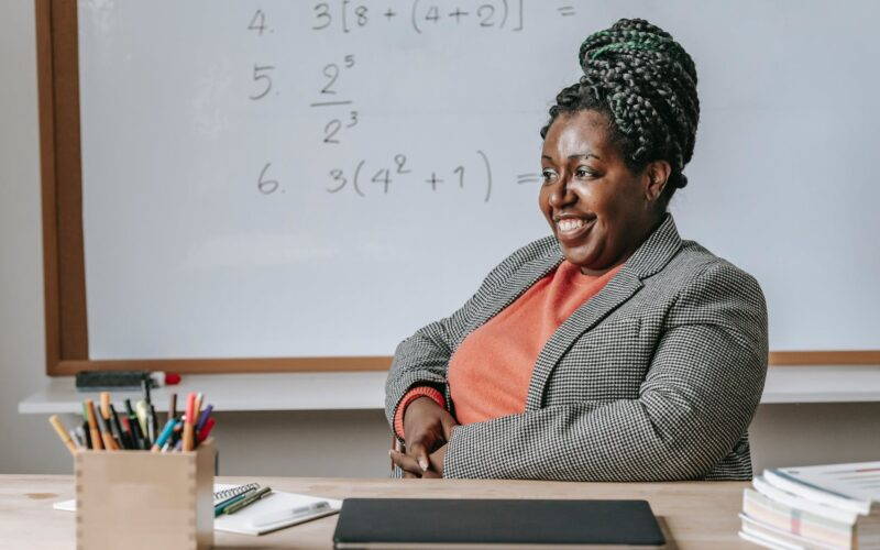 cheerful solid black woman expecting for lesson